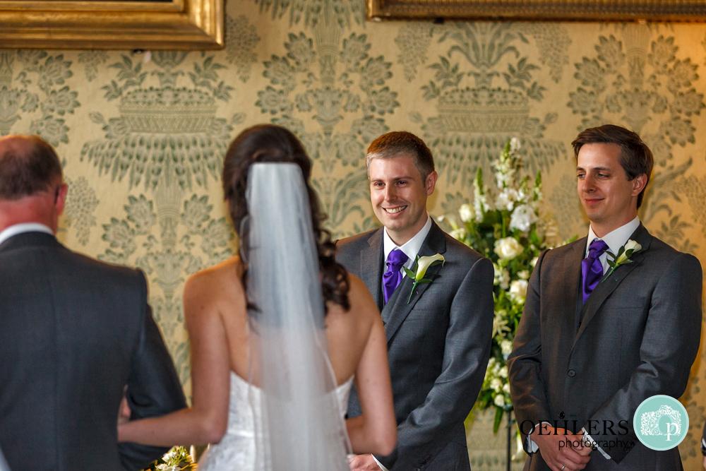 proud groom looking at his bride
