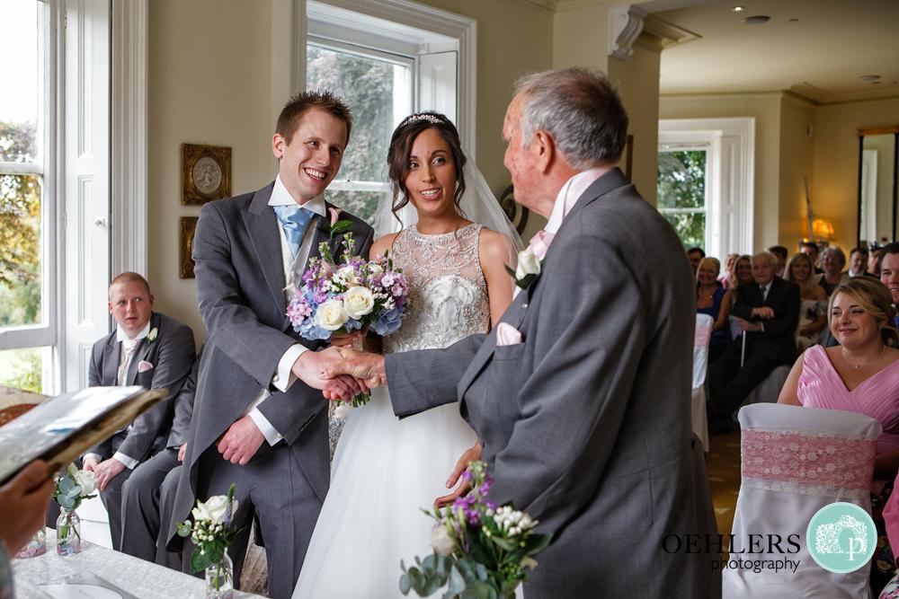 dad handing over his daughter to her groom