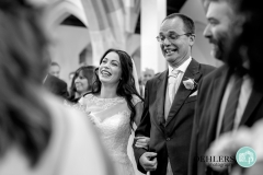 happy bride and dad walking down the aisle