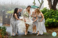 bride and bridesmaids and dad