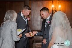 bestman giving ring to groom