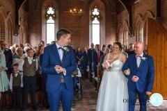happy bride entering the church