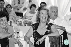 Grandmother having a good laugh at the speeches