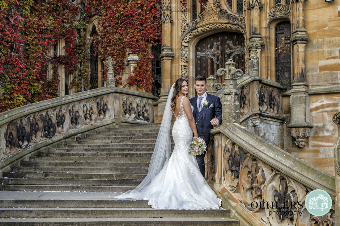 Bride and groom on magnificent staircase at Carlton Towers