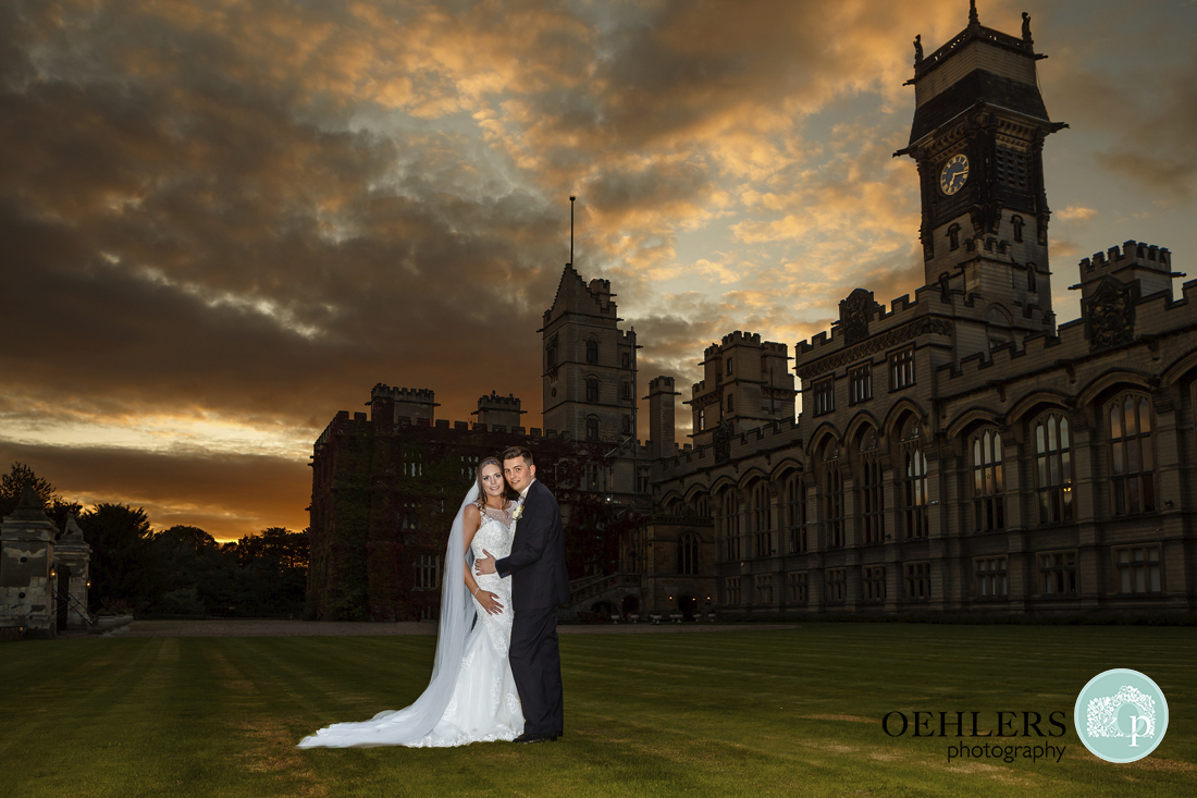 Bride and groom outside Carlton Towers at sunset