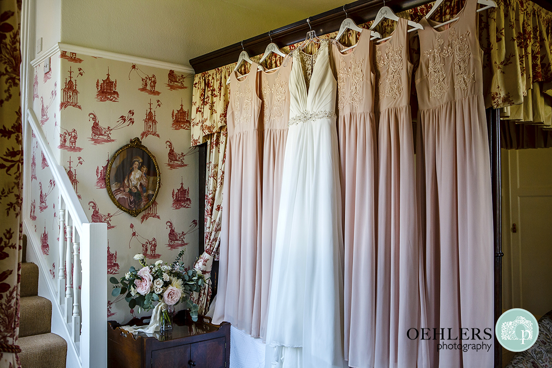 Wedding Dress and Bridesmaids dresses hanging up