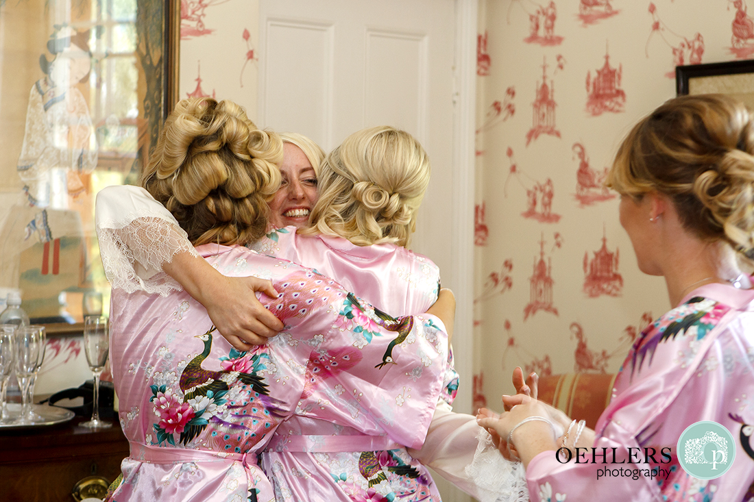 Brida hugging her bridesmaids