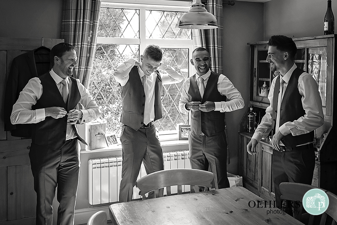Groom having a laugh with his groomsmen