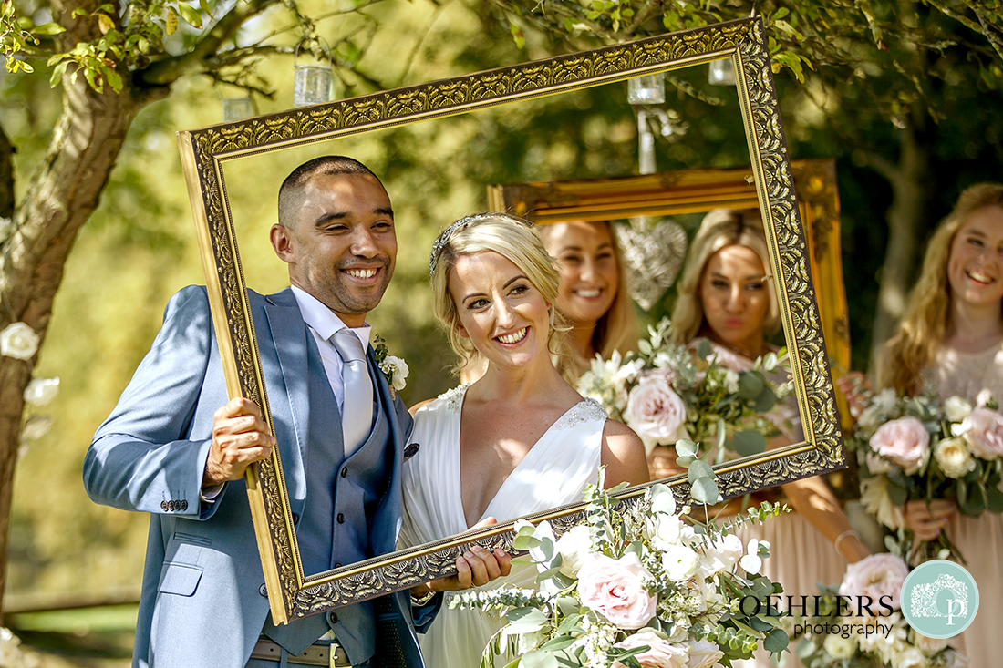Groom and Brides looking through the frame