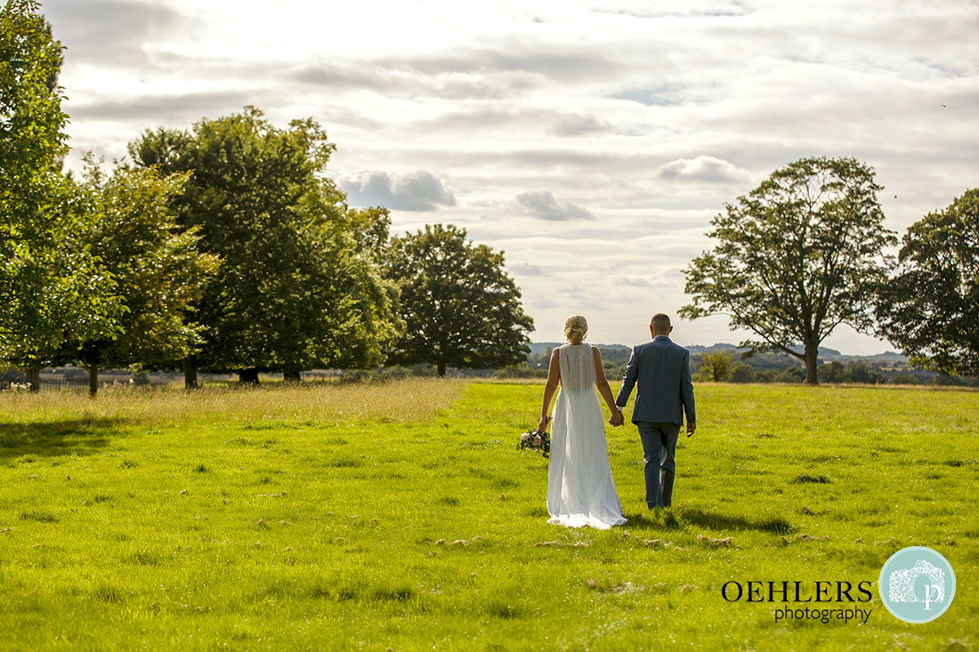 Brida and Groom taking a walk into the countryside