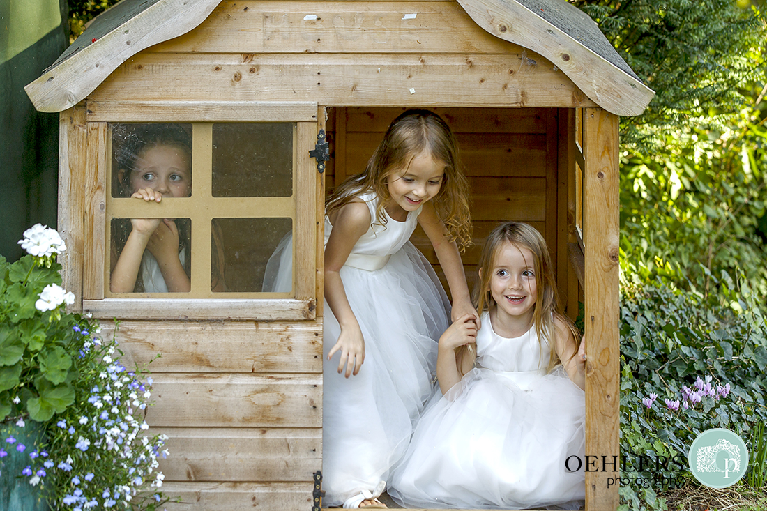 Flowergirls playing in a childrens shed