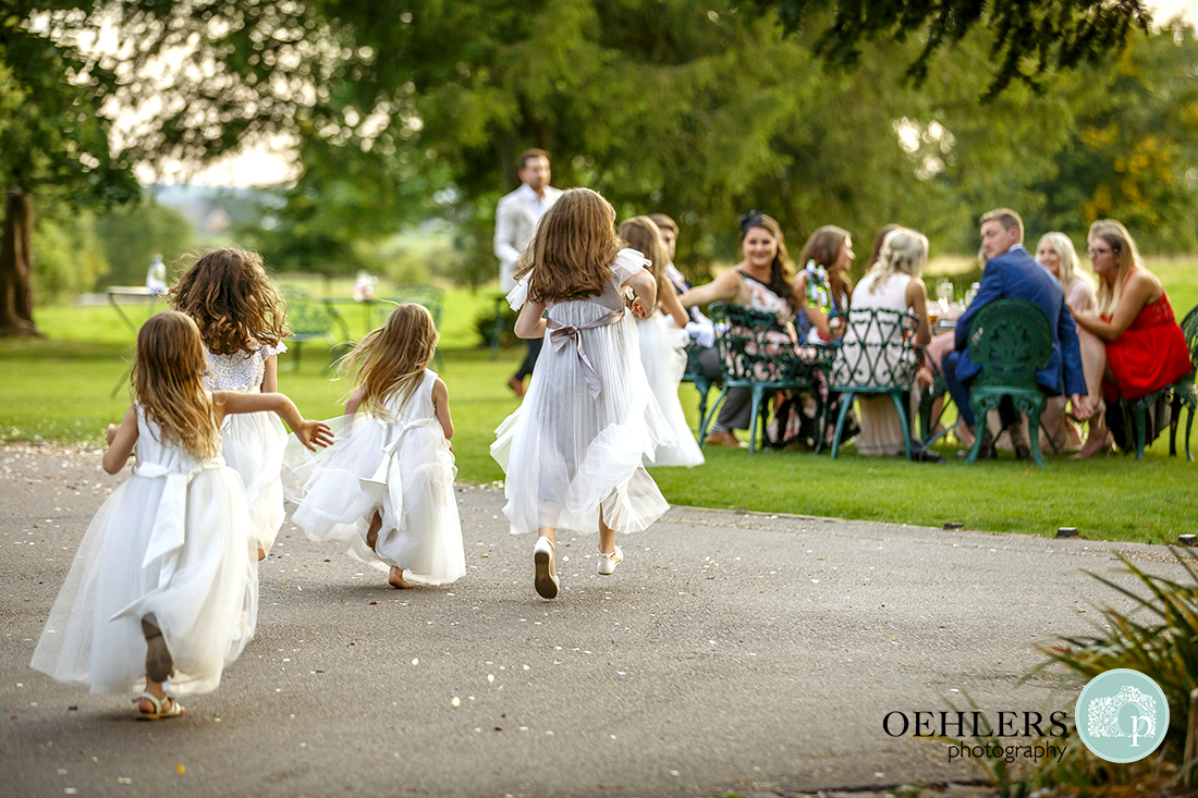 Flowergirls running towards the guests