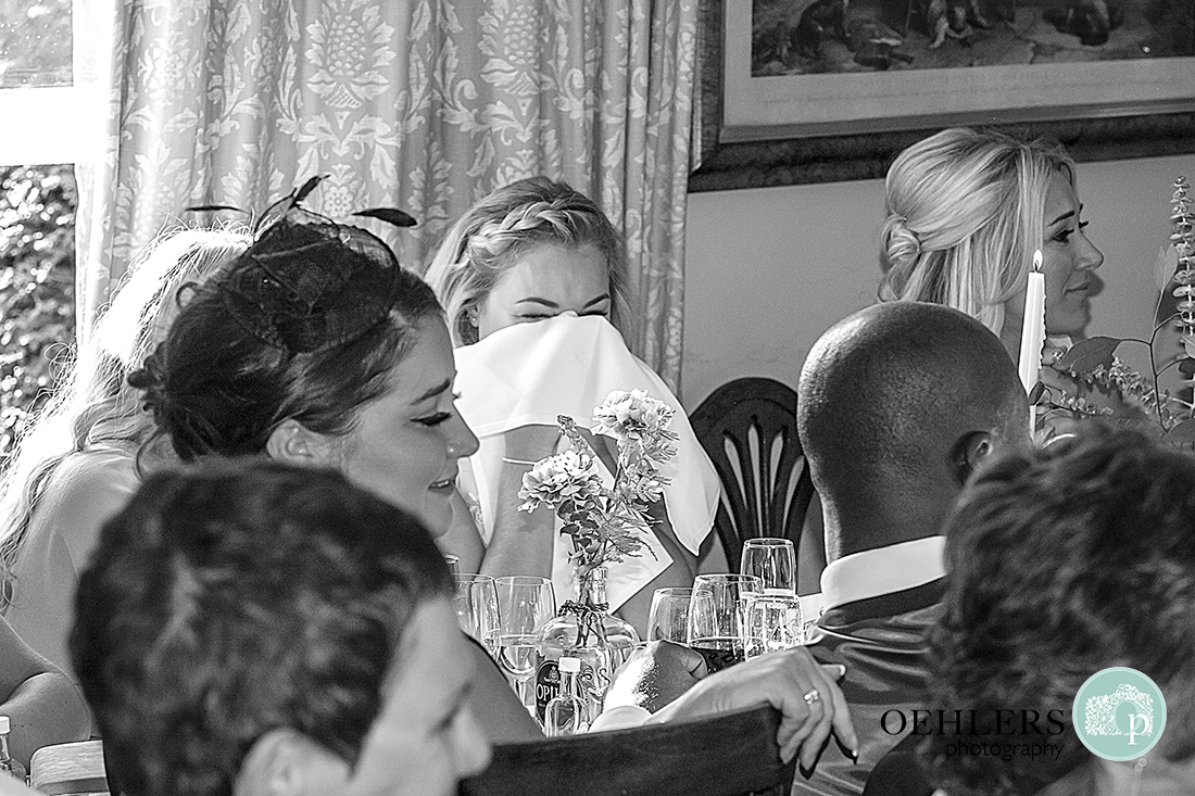 Guest using serviette to wipe away tears