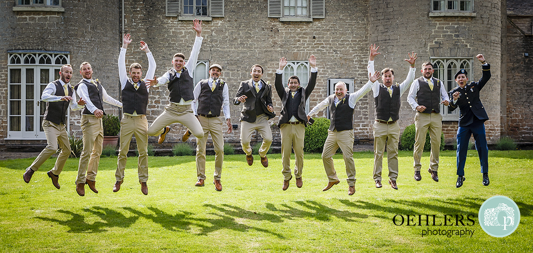 Groomsmen jumping up in the air