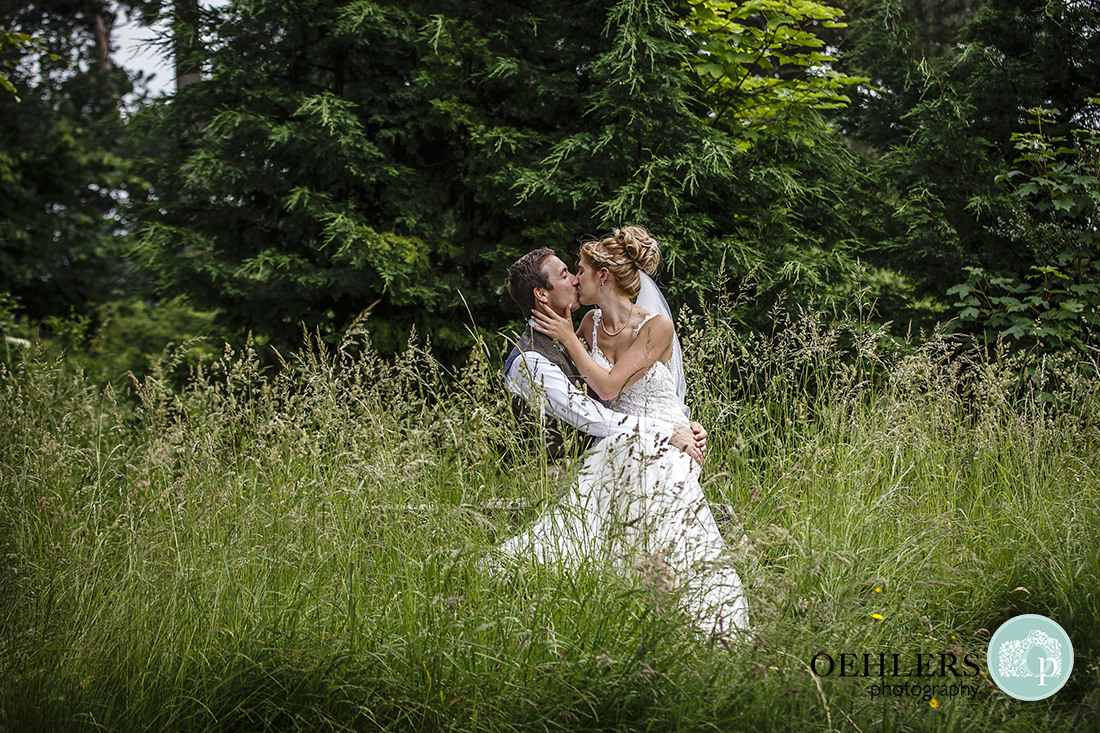 Bride and Groom in the grass