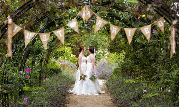 Couple in front of Just Married bunting