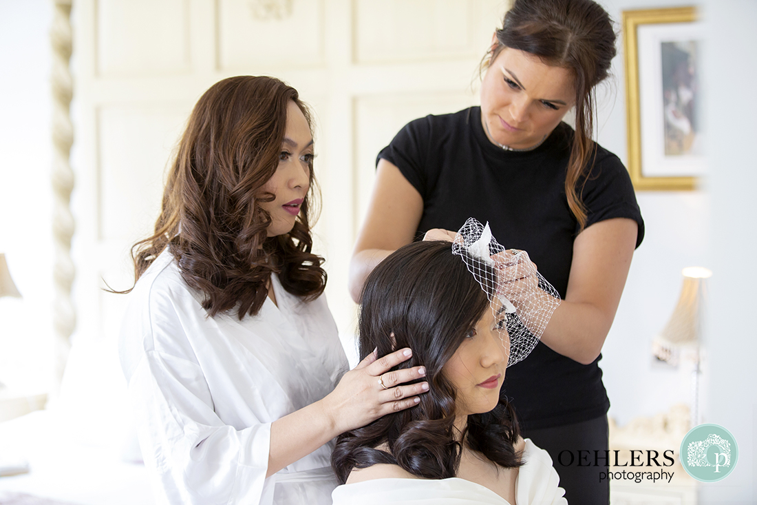 Bride helping with her sister's hair