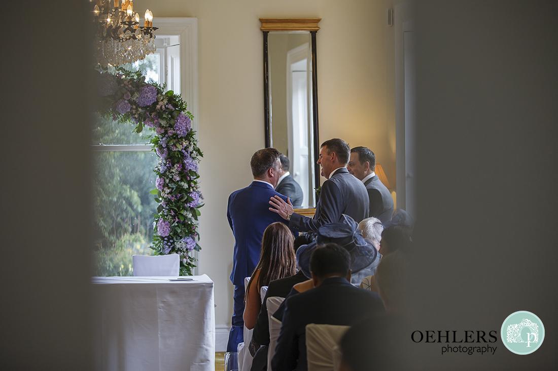 Bestman reassuring the groom in the ceremony room