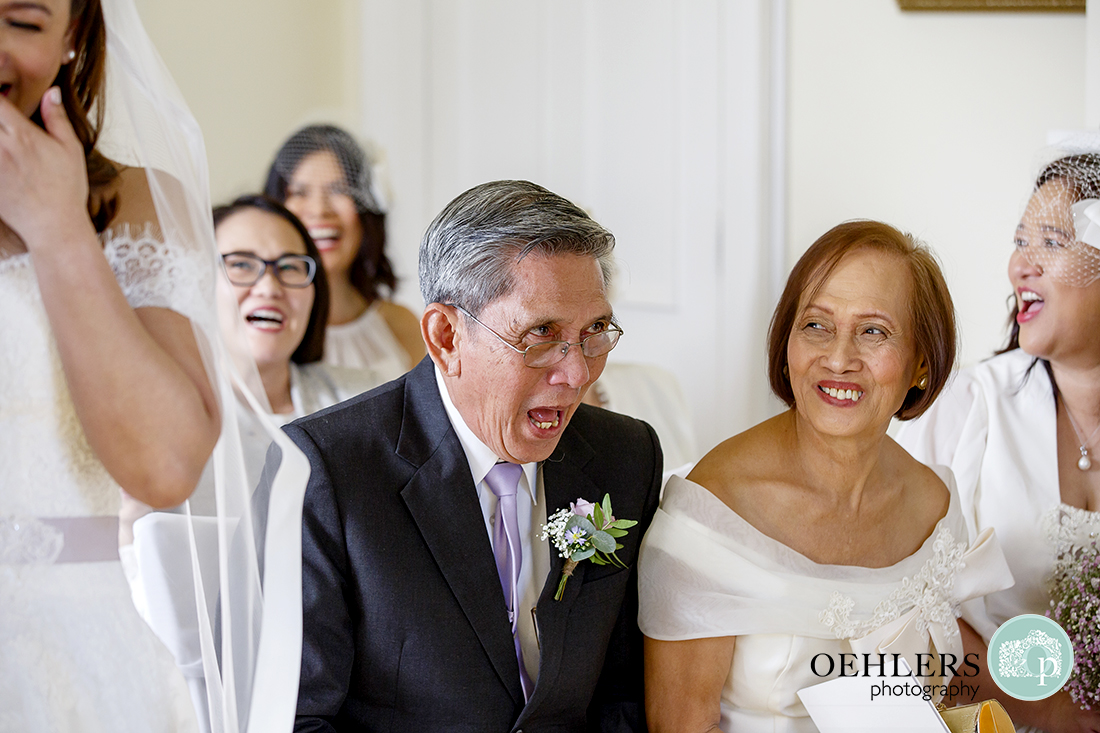 Laughter from the Bride's parents