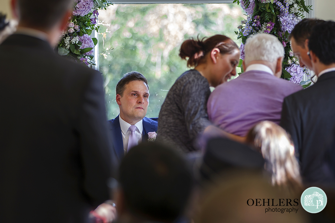 Groom looking at his dad