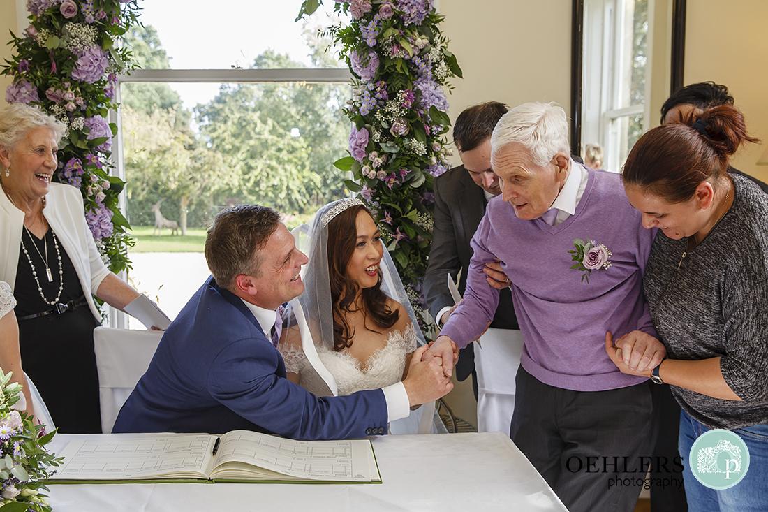 Dad congratulating the groom