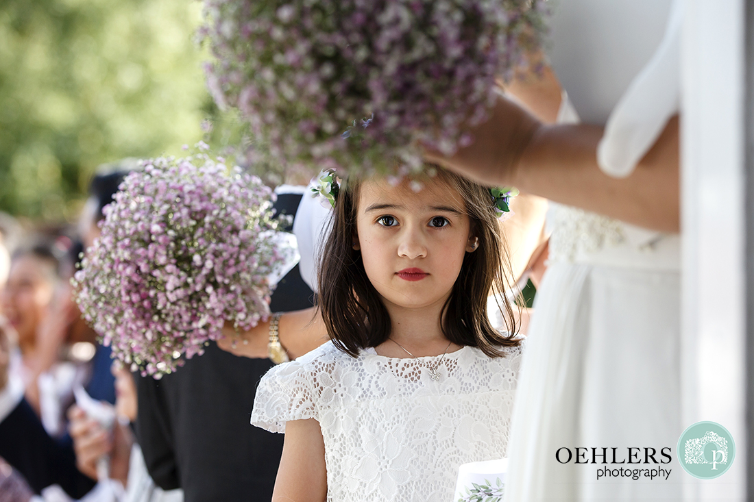 Flower Girl looking straight into the camera