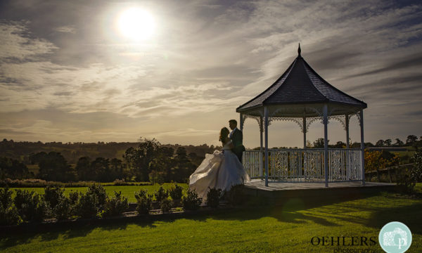 Romantic silhouette of the Bride and Groom at the gazebo