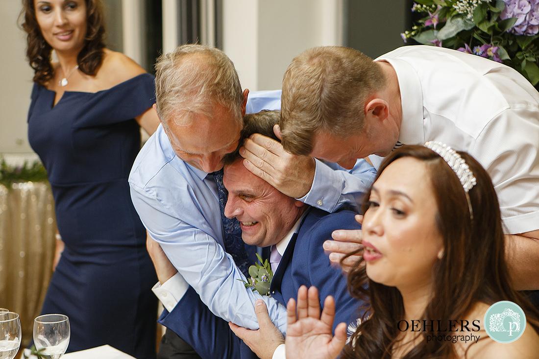 Friends congratulating the Groom
