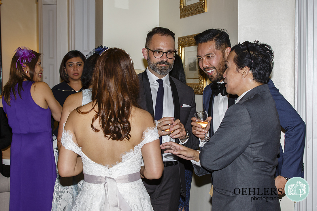 Guests talking to the Bride