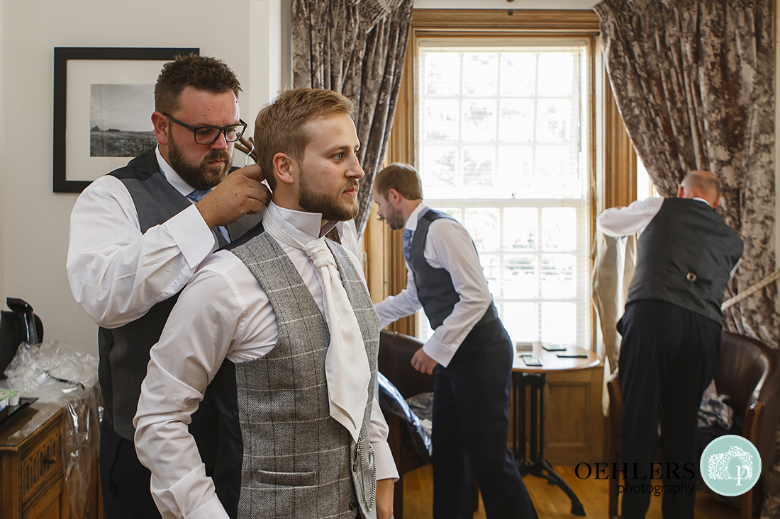 Bestman helping with the tie