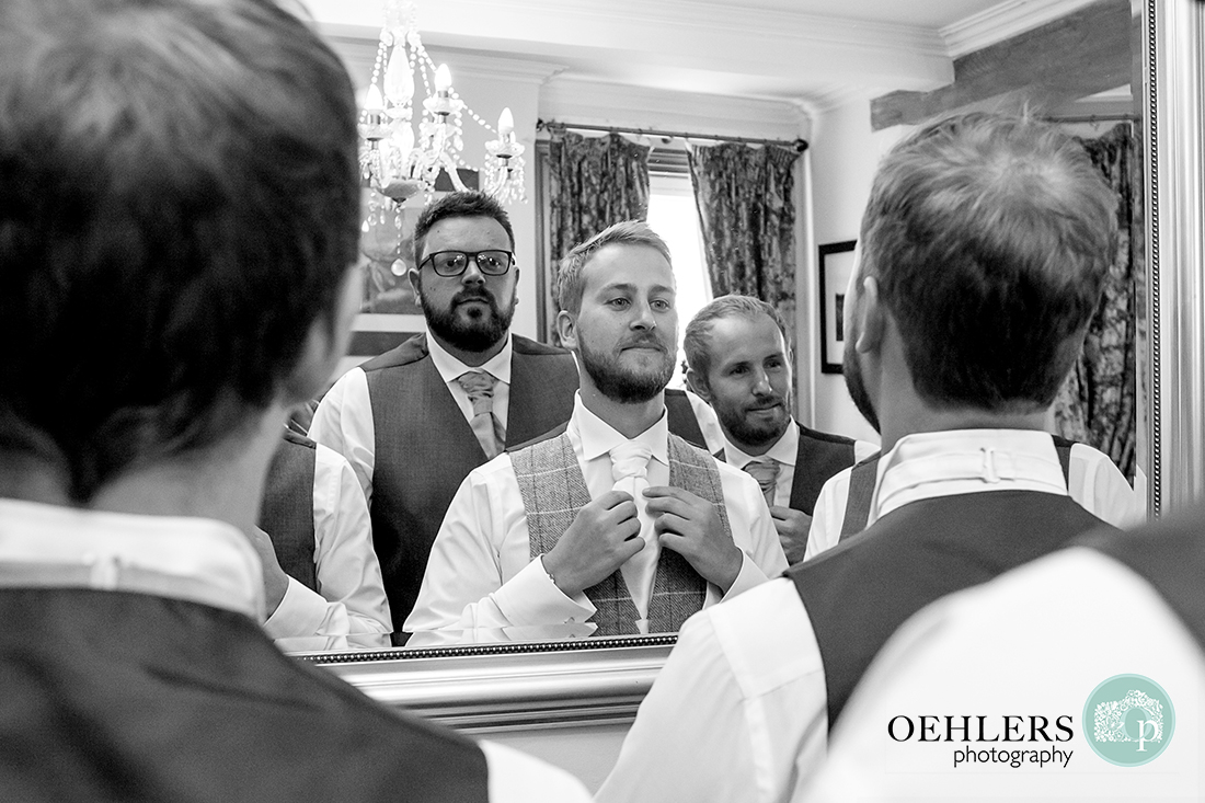 Swancar Farm Wedding Photography-Groomsmen looking in the mirror