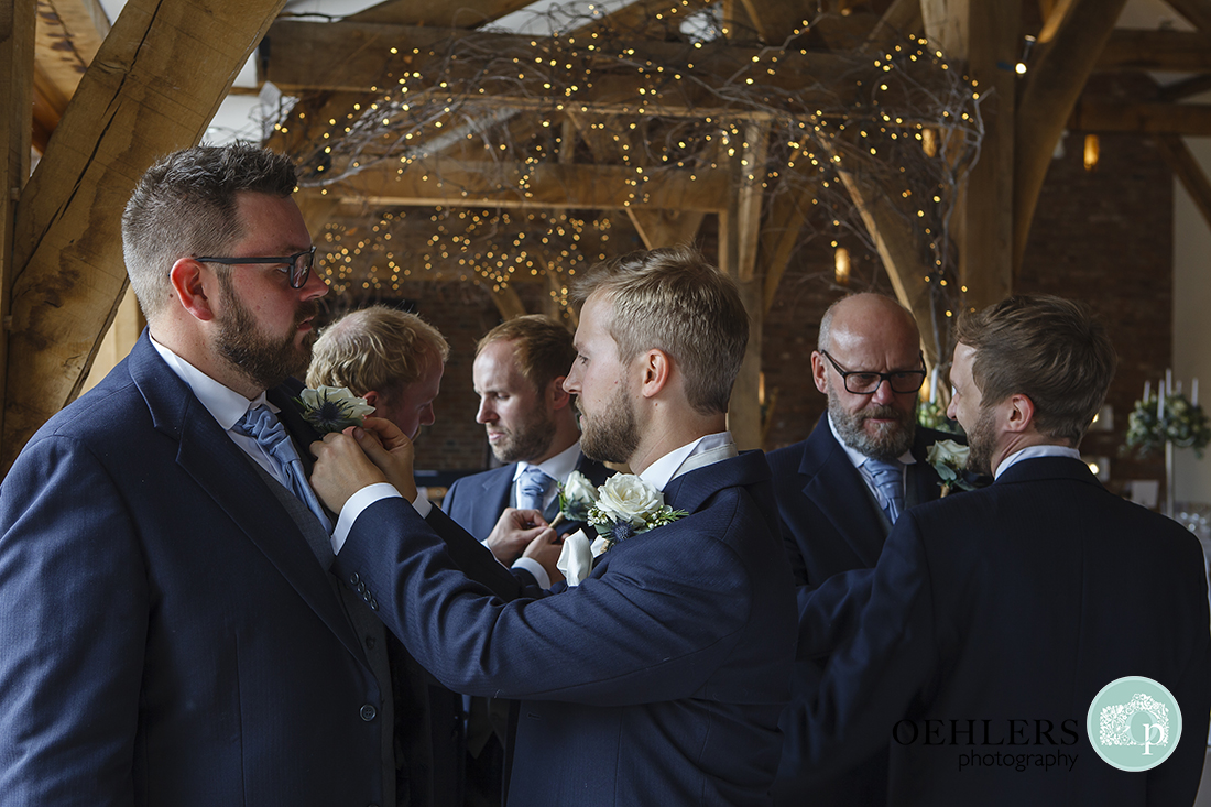 Swancar Farm Wedding Photography-Groomsmen putting on their button holes