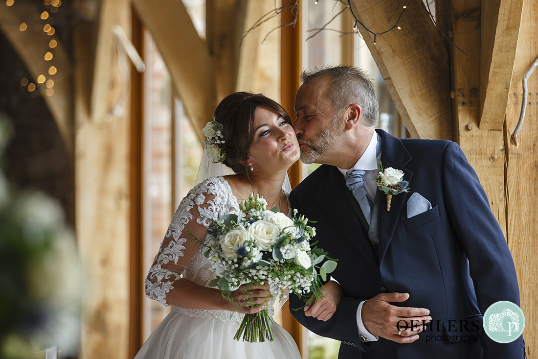 Swancar Farm Wedding Photography-Dad kissing bride on her cheek