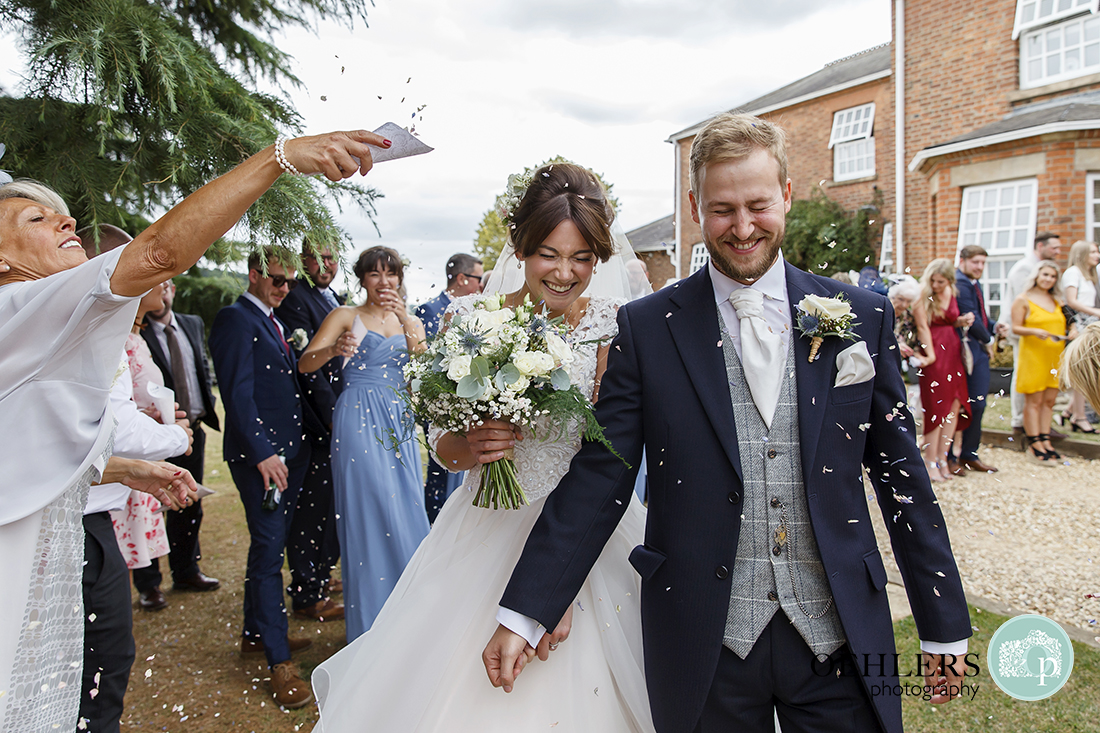 Swancar Farm Wedding Photography-Confetti thrown at the bride and groom