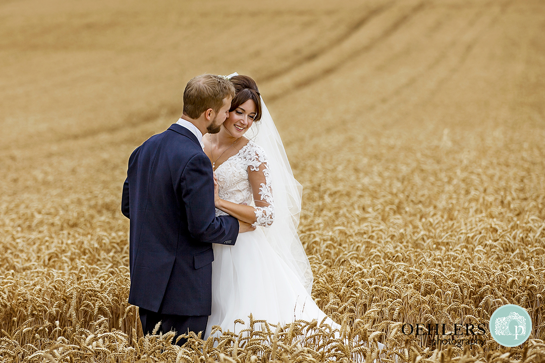 Groom and Bride in a cornfield