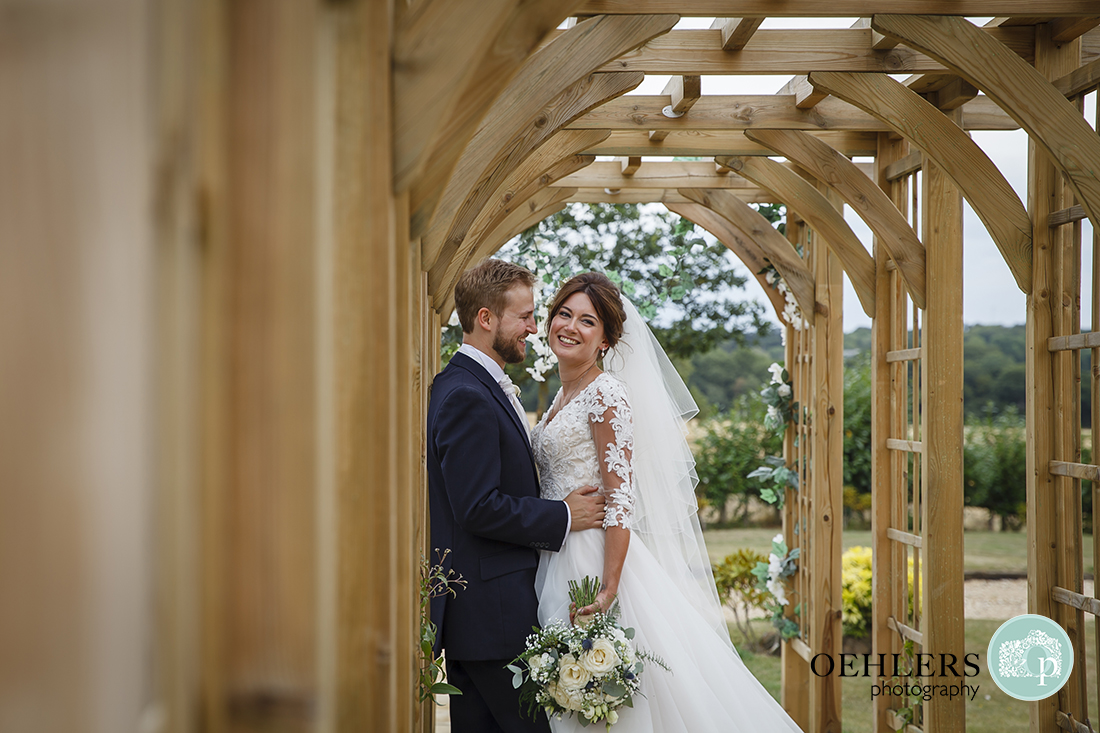 Bride and Groom under an arbour