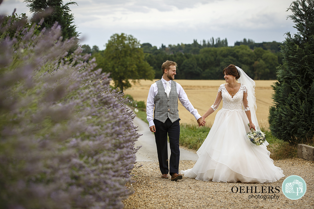 Swancar Farm Wedding Photography-Bride and Groom walking up the drive towards the venue