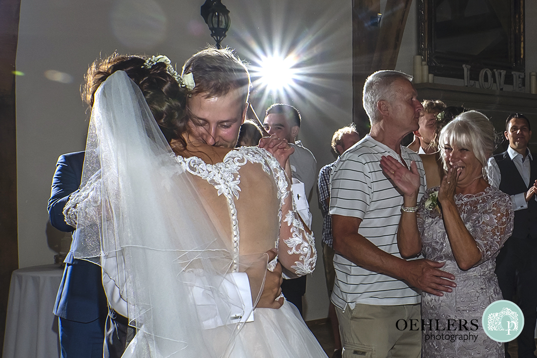 Swancar Farm Wedding Photography-Bride and Groom having a cuddle at end of first dance