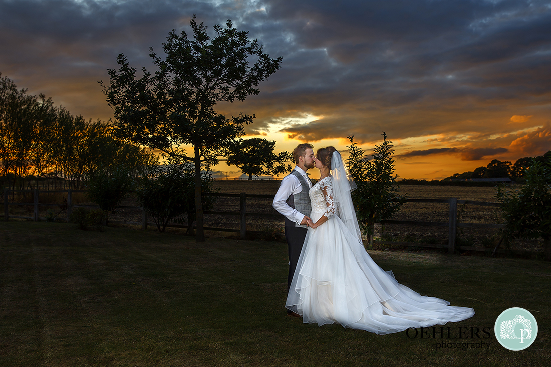 Beautiful sunset with the bride and groom