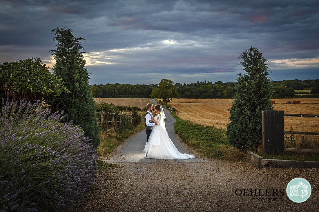 Bride and Groom with fields of countryside behind them