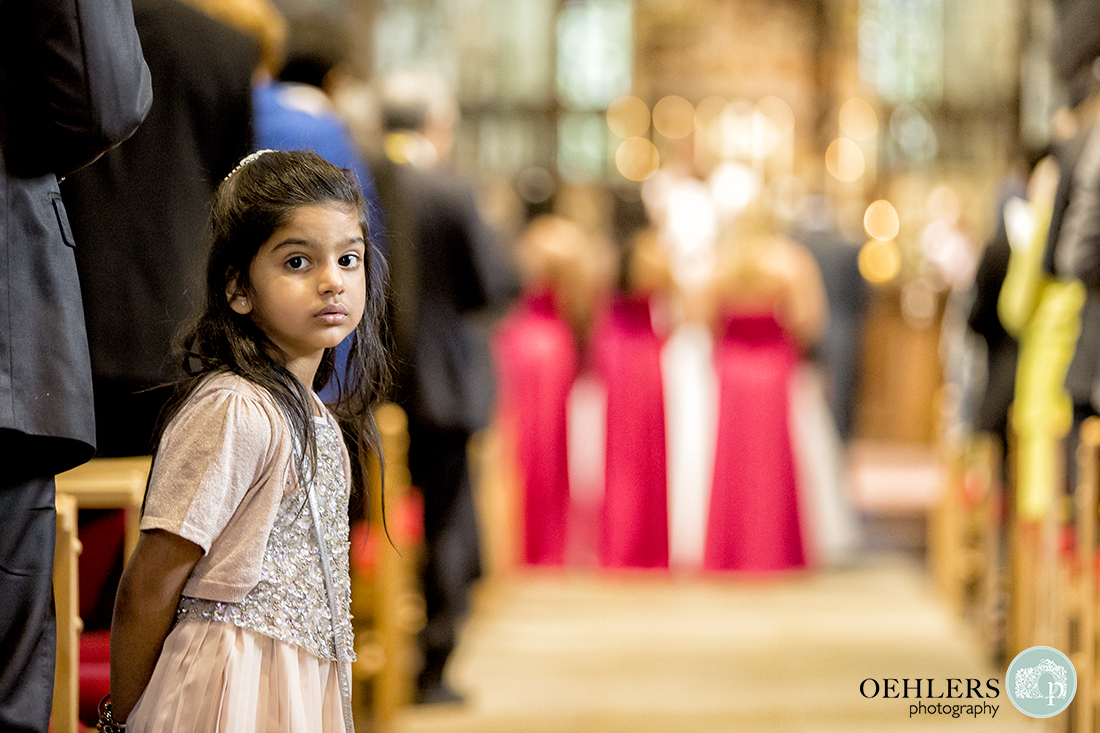 Photograph capturing a young guest looking at the camera in the aisle.
