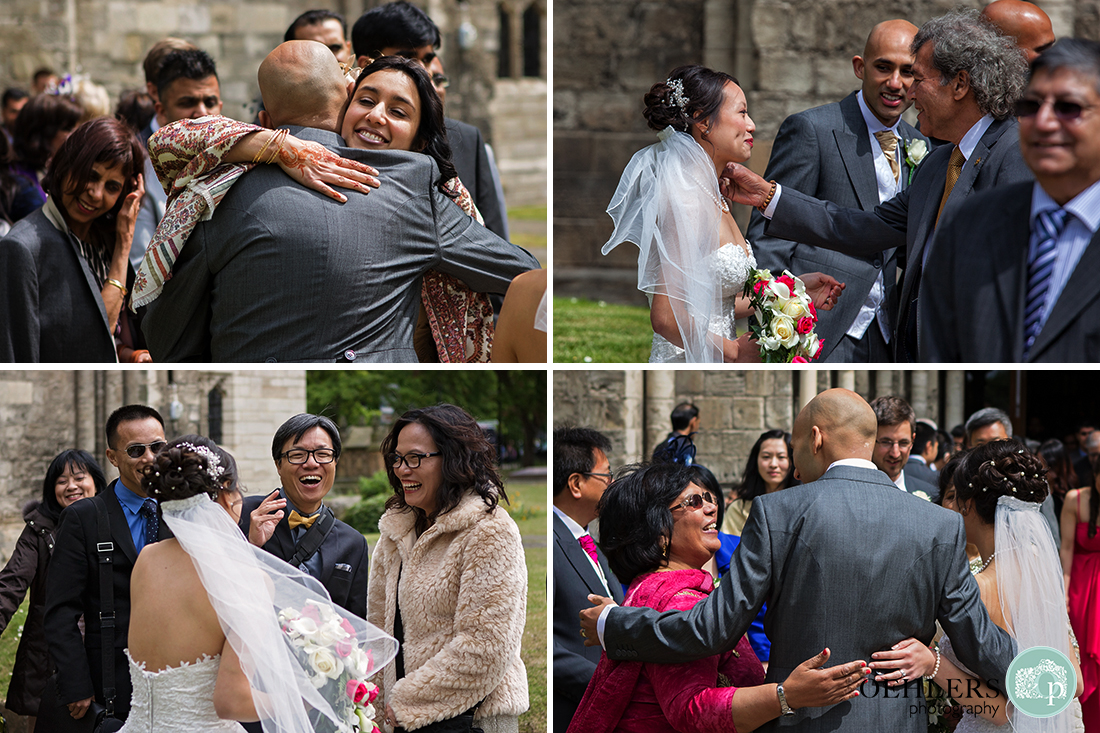 Montage of the wedding guests congratulating the bride and groom.