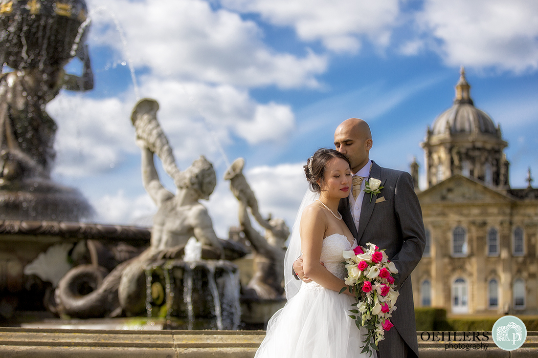 Romantic Photograph of Bride and Groom in front of the Atlas Fountain at Castle Howard.