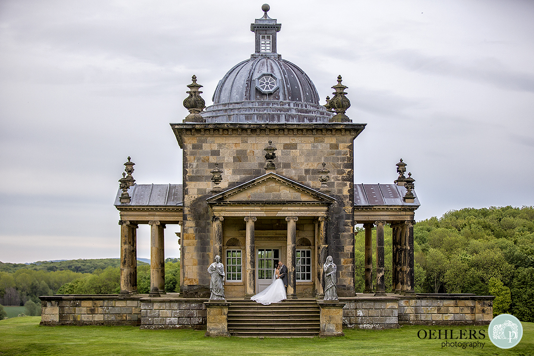 Bride and Groom at The Temple of the Four Winds at Castle Howard, Yorkshire.