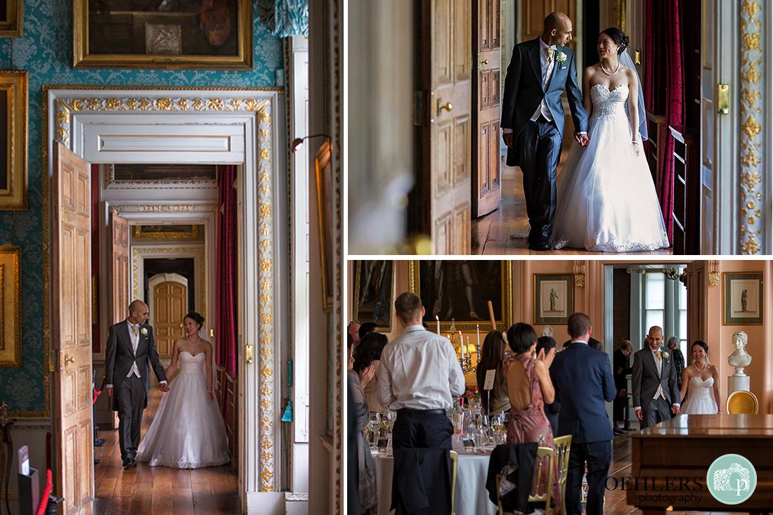 Bride and Groom walking through the corridoors of Castle Howard and entering their wedding breakfast room.
