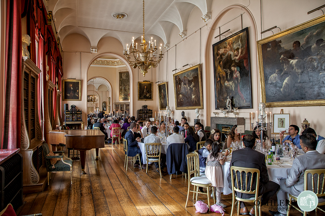 Guests seated at the exquisite wedding breakfast room in the Long Room at Castle Howard, Yorkshire.