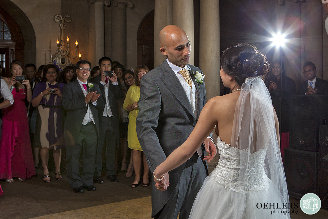 First Dance as guests look on with starburst in the right hand corner.