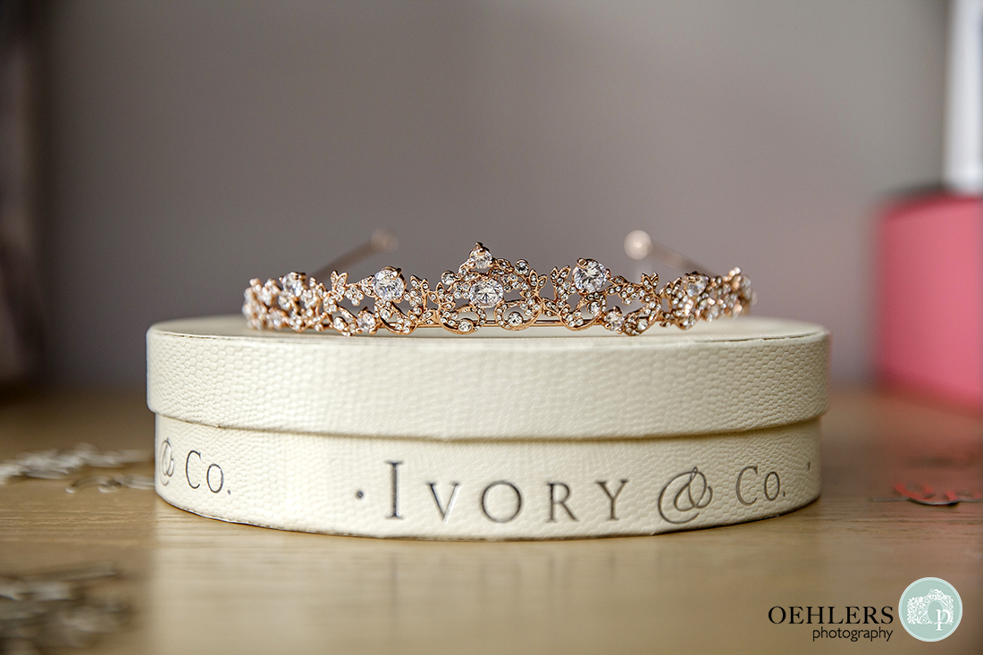 Rose-gold wedding tiara from Ivory & Co on top of their branded box.