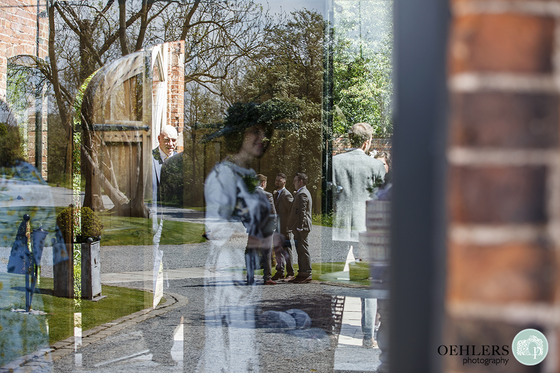 Complex reflection of guests in the courtyard and entrance hall.