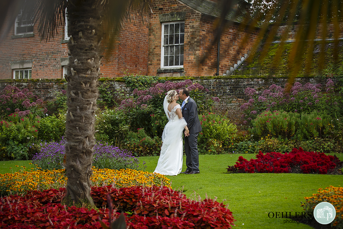 couple kissing in the gardens at Calke Abbey